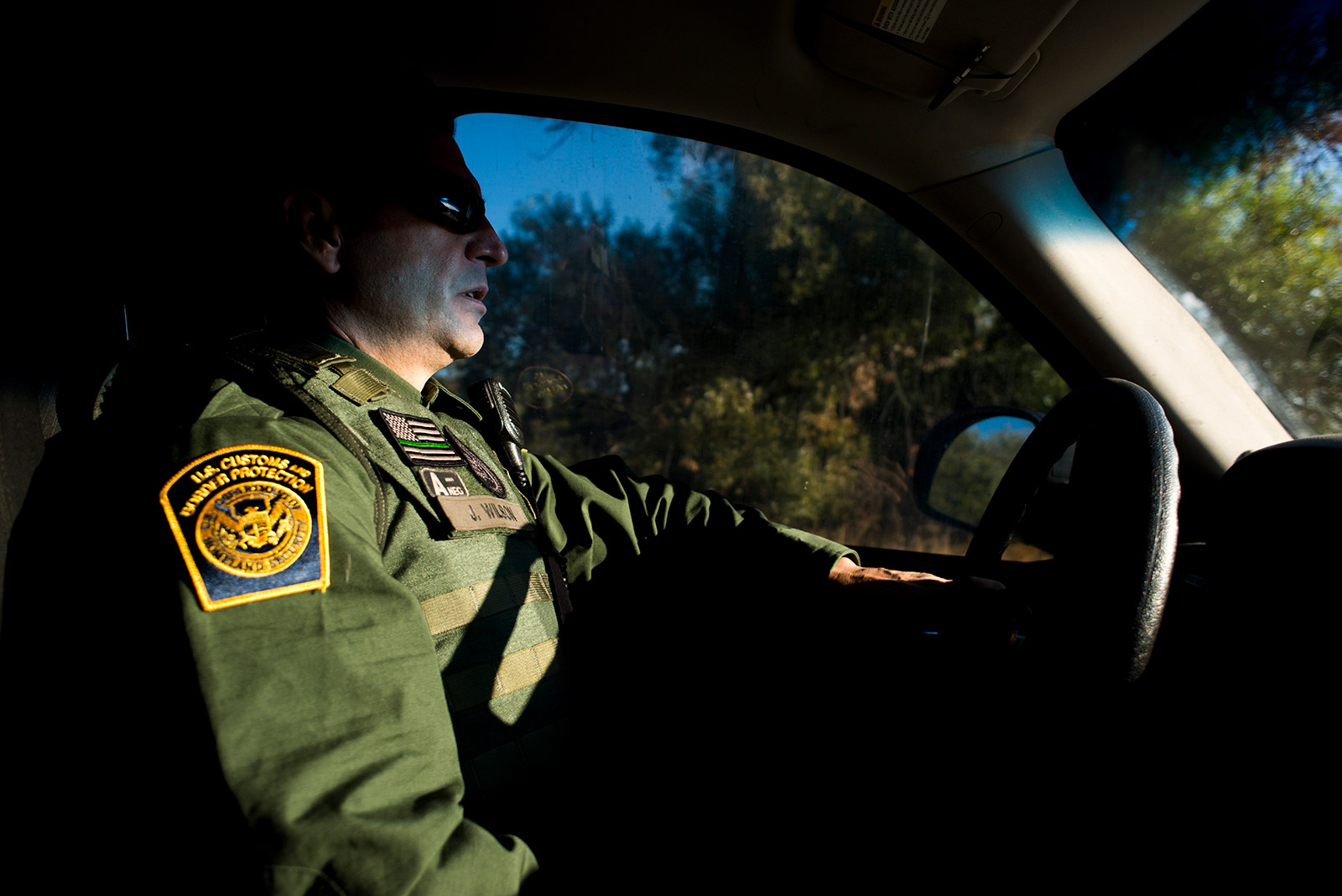 Joshua Wilson, a Border Patrol agent and vice president of the San Diego chapter of the National Border Patrol Council, drives along the U.S.-Mexico border near Jacumba in eastern San Diego County on Sept. 5, 2017. Wilson said some of the newer fencing has helped improve agent safety. <em>(Brandon Quester/inewsource)</em>