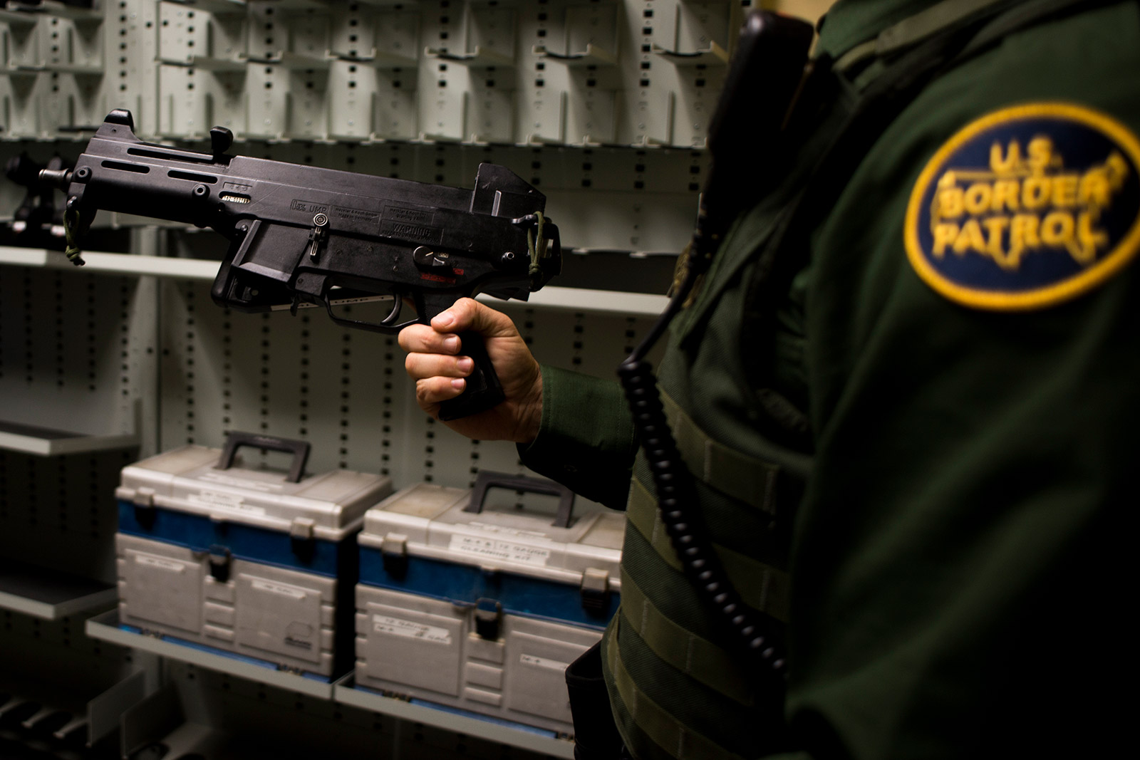 Joshua Wilson, vice president of the San Diego Border Patrol union, shows on Sept. 5, 2017, the types of weapons available to field agents for patrolling the U.S.-Mexico border. <em>(Brandon Quester/inewsource)</em>
