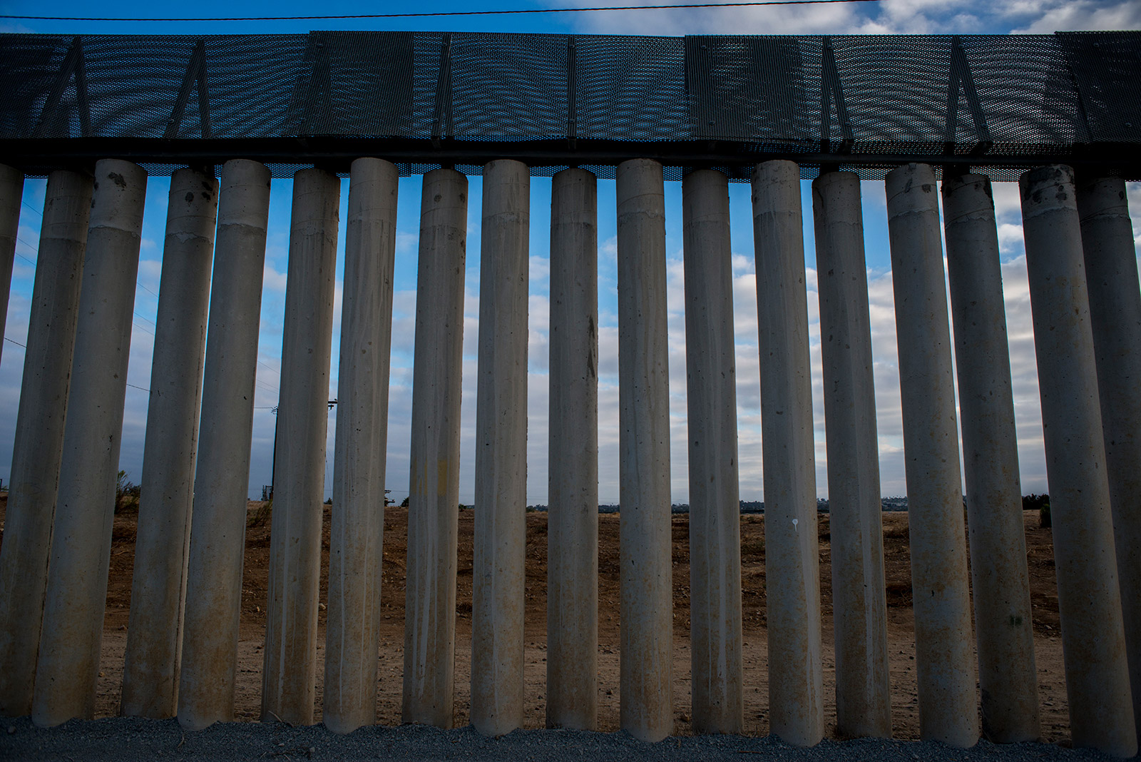 This variation of secondary fencing between the Pacific Ocean and the San Ysidro Port of Entry is made of tall concrete pillars and is topped with metal sheeting. This fencing, shown on Aug. 16, 2017, is designed to stop people and vehicles from entering the U.S. illegally. <em>(Brandon Quester/inewsource)</em>