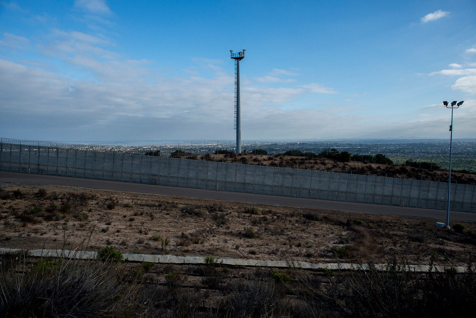 "Towers with sophisticated imaging equipment dot sections of the U.S.-Mexico border in San Diego. This tower, show on Aug. 16, 2017, is one of several technological improvements to enforcement efforts and is known as ""virtual fencing."" <em>(Brandon Quester/inewsource)</em>"