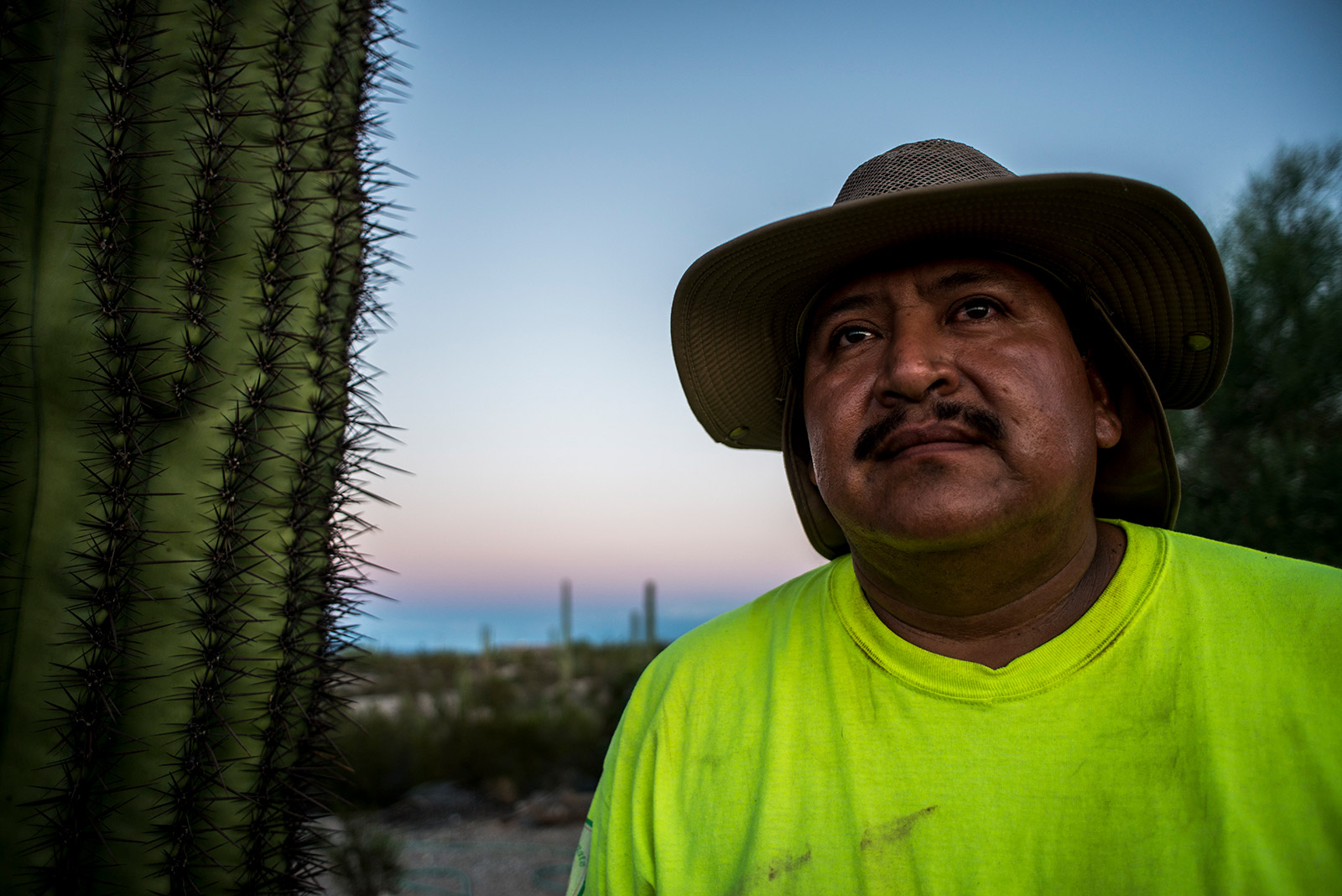 Ely Ortiz, founder of Aguilas Del Desierto, poses for a portrait on Aug. 26, 2017, at the base camp outside Ajo, Arizona, where he and nearly two dozen others prepare for daylong treks into the desert to search for missing migrants. <em>(Brandon Quester/inewsource)</em>