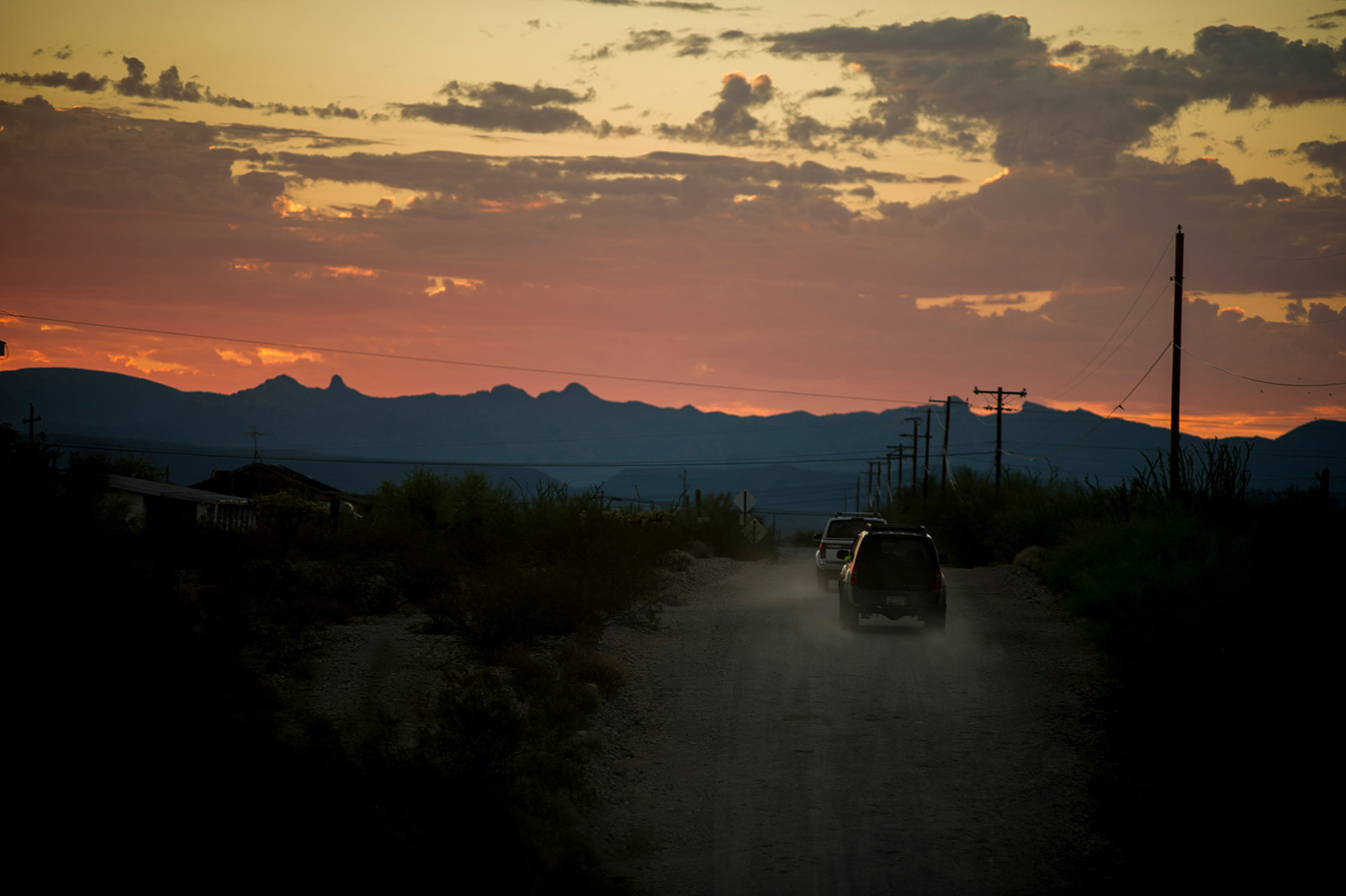 Trucks and SUVs leave a camp outside Ajo, Arizona, on Aug. 26, 2017, for a drive to Organ Pipe Cactus National Monument along the U.S.-Mexico border where the occupants will search on foot for missing migrants. <em>(Brandon Quester/inewsource)</em>