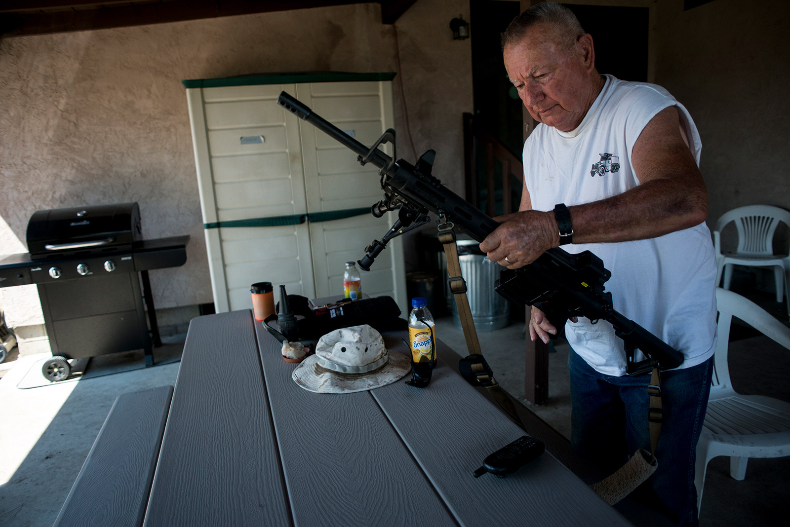 Bob Maupin removes ammunition from his AR-10, or ArmaLite Rifle, after returning from a tour of his Boulevard property along the U.S-Mexico border on Aug. 30, 2017. <em>(Brandon Quester/inewsource)</em>