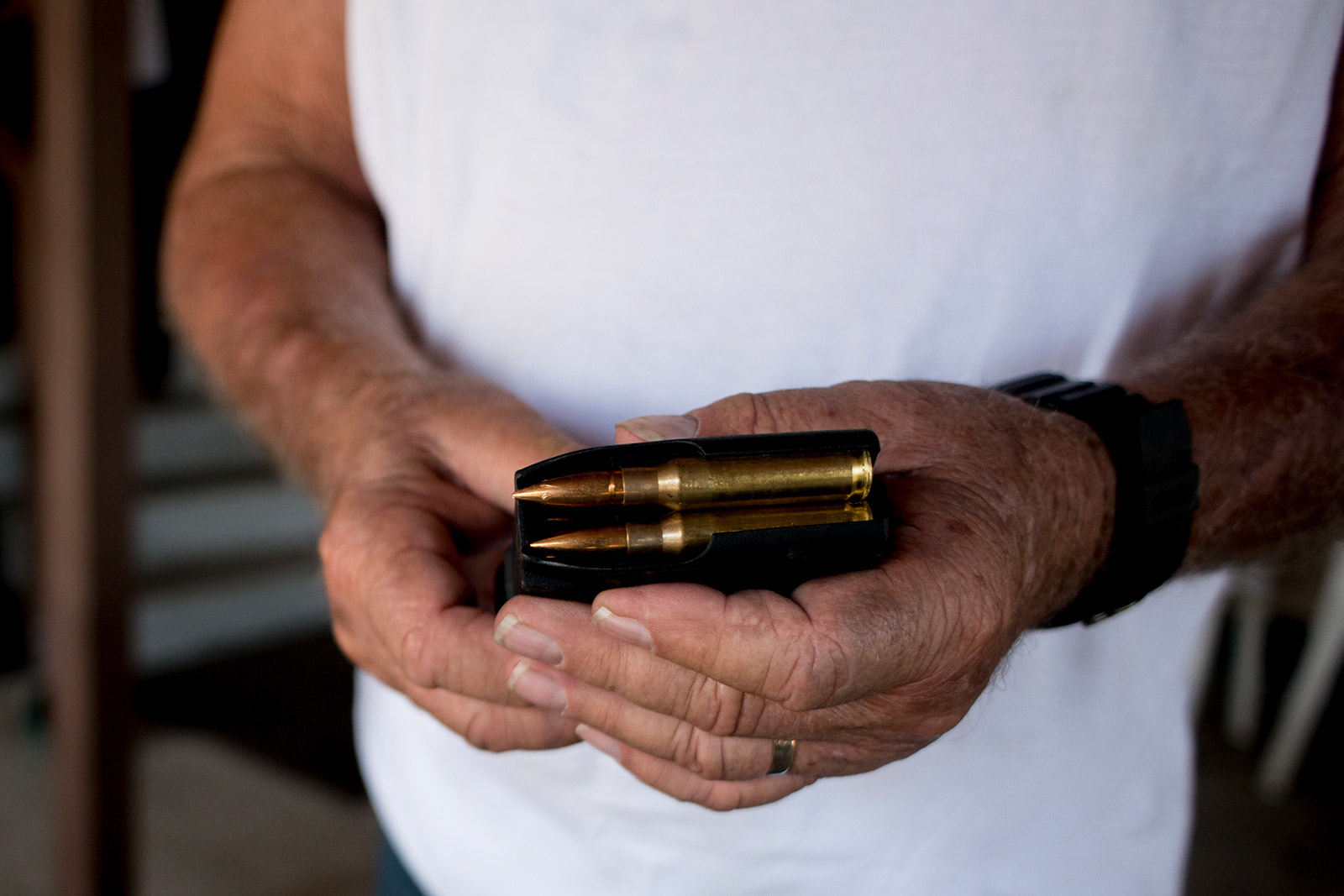 Bob Maupin holds a clip with .308-caliber ammunition for his AR-10, or ArmaLite Rifle, on Aug. 30, 2017, after touring his property in Boulevard, which is near the Mexican border. <em>(Brandon Quester/inewsource)</em>
