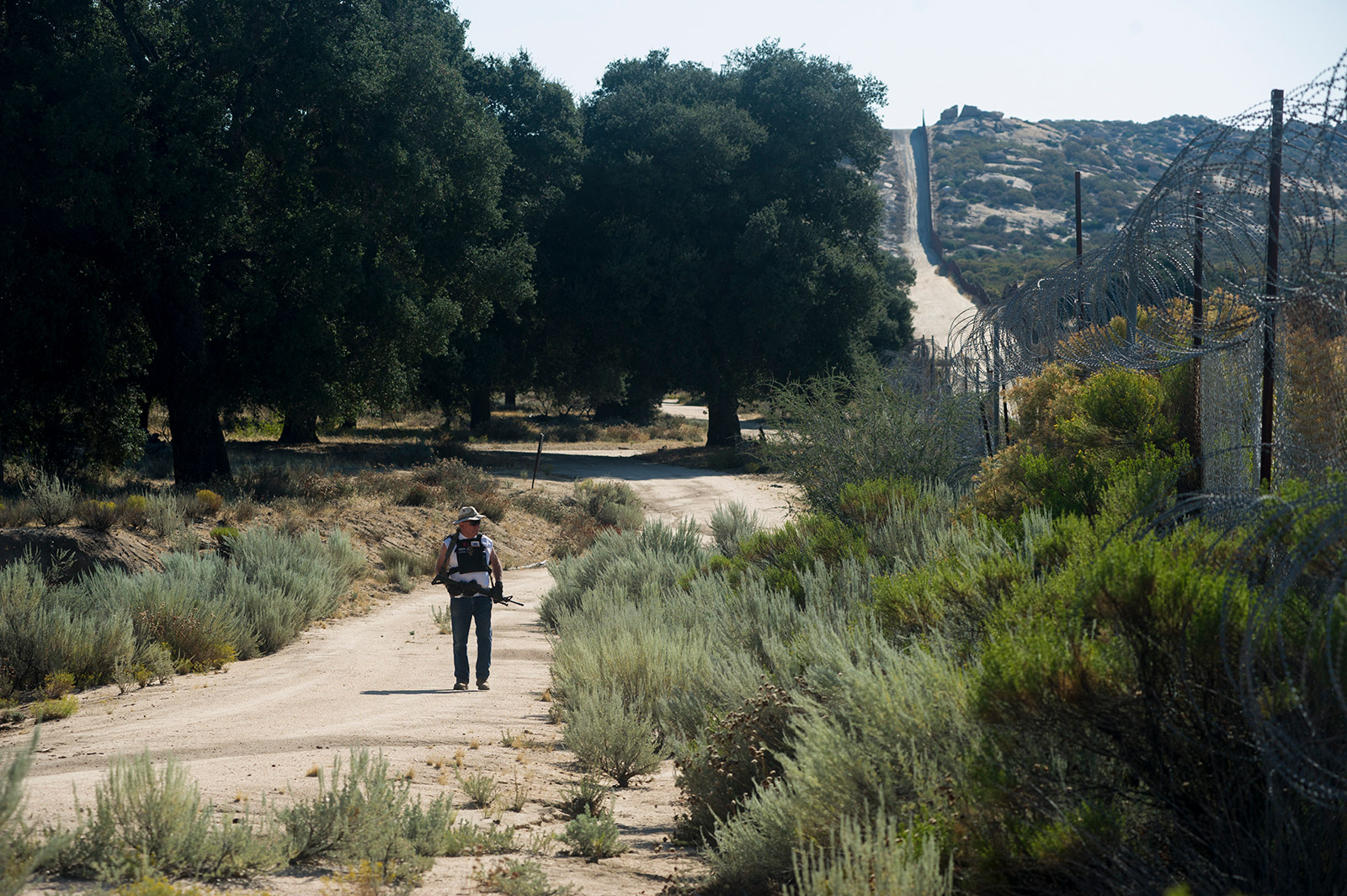 Bab Maupin, shown on Aug. 30, 2017, walks along his stretch of property that borders Mexico. His 250-acre ranch is in Eastern San Diego County near the community of Boulevard. <em>(Brandon Quester/inewsource)</em>