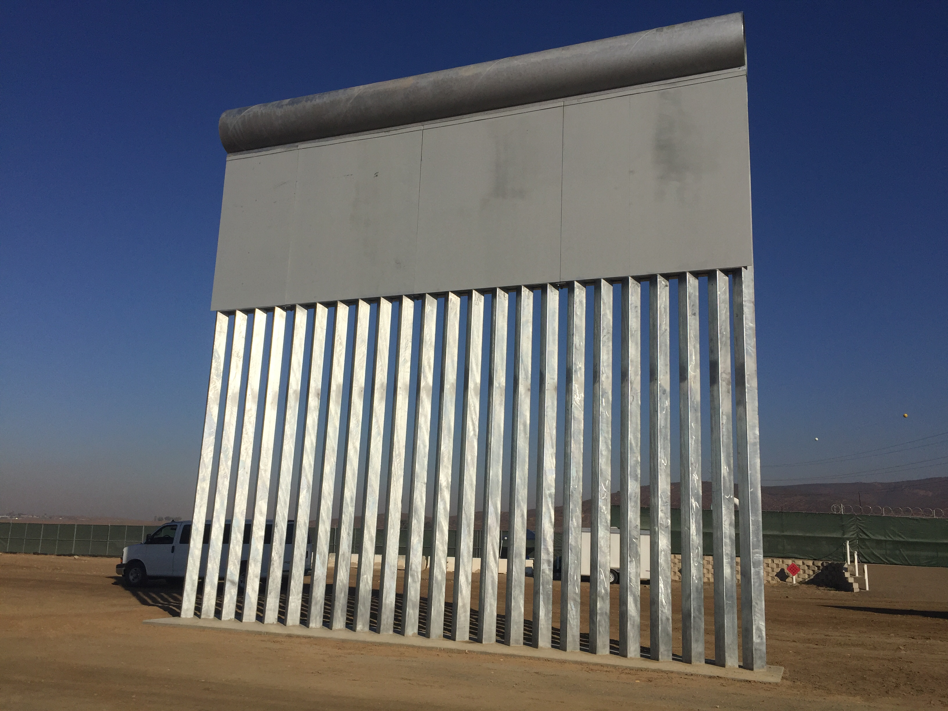 A border wall prototype stands by the U.S.-Mexico border, Oct. 26, 2017. <em>(Elma Gonzalez/KPBS)</em>